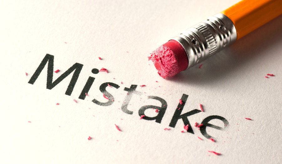 Removing word with pencil's eraser, Erasing mistake